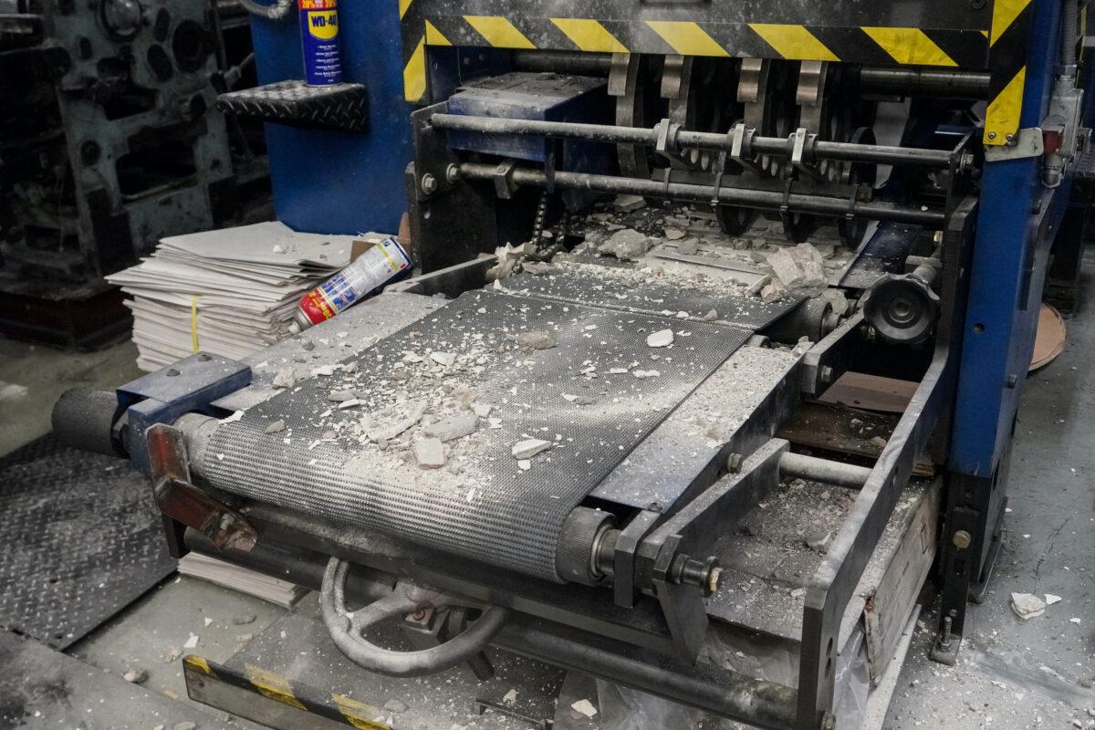 Bouwpuin-bovenop-drukpersapparatuur